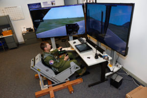 Cadet 1st Class Cody Haggin uses a dynamic motion seat in the Air Force Academy's Warfighter Effectiveness Research Center Oct. 23, 2015. The seat is part of a three-year study to test how using a dynamic motion seat can improve flight training. (U.S. Air Force photo)