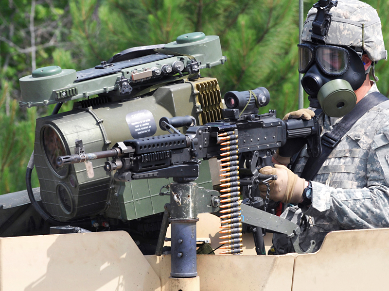 M249 machine gun from the gunner's turret on a tactical vehicle