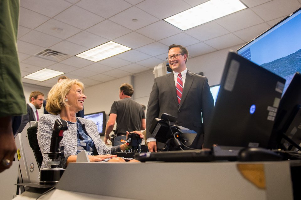 U.S. Secretary of Education Tries a ACME Dynamic Motion Seat