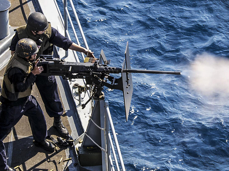 Navy Sailors Train on a .50-caliber Machine Gun